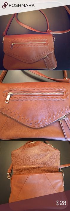 Francesca's brown crossbody Brown crossbody purchased recently from Francesca's boutique. In great condition, only worn a few times. Very good quality. Francesca's Collections Bags Crossbody Bags