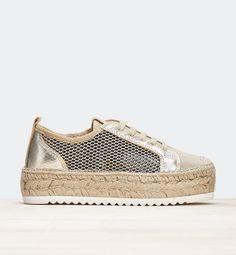 http://www.polinetmoi.com/alpargatas-plataforma/alpargata-sneaker-metalizada.html#/shoes_size-36/color-platino vidorreta