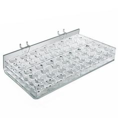 Azar Displays 225582 48-Compartment Cosmetic Tray for Pegboard, Slatwall / Counter Top by Azar Displays. $22.00. This 48-compartment tray measures 12-Inch W x 7.5-Inch D x 2-Inch H. Round slot measures 0.9375-Inch in diameter. Use this display on pegboard, slatwall or counter top for easy mounting.