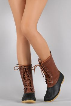 Description These duck mid-calf boots feature a combination of vegan leather/PVC upper, stitching accents, lace up front, and low heel. Successful Women, Duck Boots, Mid Calf Boots, Online Boutiques, Feminine, Lace Up, Booty, Pairs, Toe