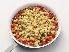 Get this all-star, easy-to-follow Mini-Gnocchi Bolognese recipe from Food Network Kitchen