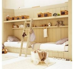 10 Inventive Bunks, Cabin Style | 6. Use the walls. If you've got drawer storage under the beds (a must) and you don't need the extra sleeping space you get with bunk beds, you can treat yourself to some open shelving to display your most fabulous toys and stuffed animals ... and birdhouses. . . .    Another idea in a setup like this would be to run the ladder on wheels and a track, making the upper shelving even more accessible.