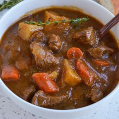 This Irish stew is slow cooked chuck roast, onions, garlic, carrots and potatoes in a rich flavorful beef gravy with a little bit of stout beer. It is always a huge hit and so incredibly easy to make. I love to serve this tasty dish with fresh Homemade Biscuits or crusty baguettes with soft creamy butter. This time of the year is perfect for all kinds of hot slow cooked comfort dishes like stews and soups This stew is one of my favorites and will quite literally have you licking your bowl. Hearty Stew Recipe, Hearty Beef Stew, Slow Cooker Times, Slow Cooker Recipes, Creamy Potato Soup, Irish Stew, Beef Gravy, Carrots And Potatoes, Beer Recipes