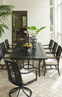 Tropical outdoor dining space with Tommy Bahama Outdoor Living Furniture.