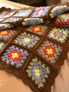 Your place to buy and sell all things handmade - Örgü modelleri - Colourful crocheted granny square blanket, afghan, throw. The blanket has a brown border and a vari - Crochet Blocks, Granny Square Crochet Pattern, Crochet Squares, Crochet Granny, Crochet Blanket Patterns, Granny Square Häkelanleitung, Granny Squares, Crochet Diy, Knitted Blankets
