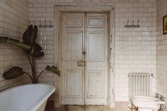 The All-Vintage Renovation by Quintana Partners in Menorca, Spain - Remodelista Cabinet D Architecture, Interior Architecture, Interior And Exterior, Menorca, Rue Verte, Vintage Apartment, Classic Bathroom, Dream Apartment, Home Decor Inspiration
