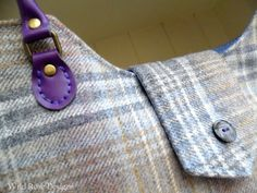 'Jo' tote bag in a blue, brown and grey wool check with purple leather handles.  £80