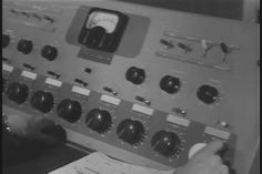 Army filmmakers shoot a recoilless rifle and an ambulance and the images are recorded on a film recorder in a television studio in the 1950s. (1950s) - SD stock video clip