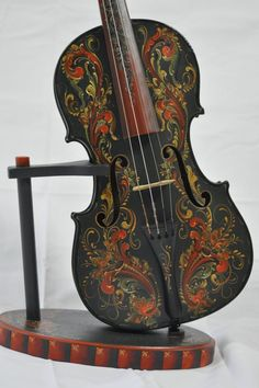 Beautiful Violin front Rosemaling by Andrea Herkert. My great grandmother painted beautiful Victorian scenes on her piano. I never thought of people painting their instruments until then.