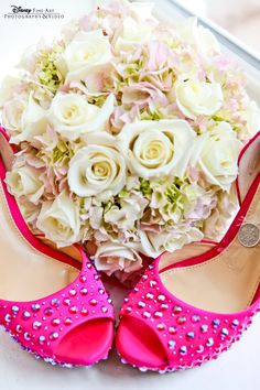 This Disney bride's pop of pink accents her soft floral bouquet perfectly #Disney #wedding #heels