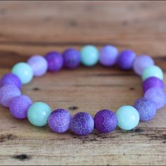 """Purple agate and jade bracelet 6"""" Purple agate and jade stretchy bracelet- protection, strength, and harmony. Great for balancing yin/yang; or just to add a pop of color to your outfit! Brand new. Price firm. No trades please. Jewelry Bracelets"""