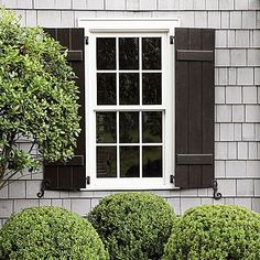 Cottage Charm - Get Shutters Right - Board-and-batten shutters lend a more relaxed feel than louvered ones. Regardless of the style, shutters should be sized to be functional and finished with shutter dogs. Cedar Shutters, Black Shutters, Window Shutters, Exterior Shutters, Cottage Shutters, Outdoor Shutters, Wooden Shutters, Houses With Shutters, Classic Shutters