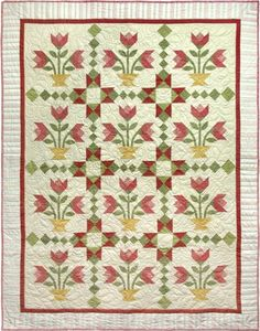 Tulips from the Past -- I like the stripe fabric used in the outer border and the mitered corners.