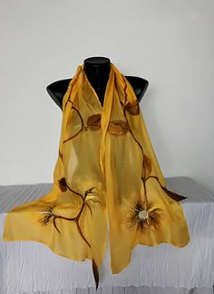 Unique nuno felt scarf. One of a kind soft beautiful nuno felting scarf hand - felted on cotton/viscose blend or silk, eco fashion. Floral scarf with yellow flowers and leaf. Original model, airy and delicate wrap. Fabric forms a beautiful folds. Shawl suitable for all seasons, for any occasion - for daily, beach use or party. It can be worn in a number of ways. Excellent gift for women. Request a custom order and have something made just for you a combination of other colors: Fabric - ...
