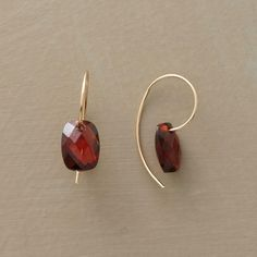 "ALMANDINE GARNET EARRINGS -- Notable for their rich, wine-red hue, the gems in these faceted almandine garnet earrings seem to float beneath the ears, simply threaded on curving French wires. 14kt gold. Handcrafted in USA exclusively for us. 5/8""L."