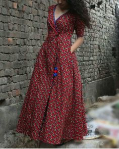 Shop online Brick red wrap dress Red maxi wrap dress with with bright trims on front tie-ups with a contrasting front inner panel. This beautiful motif flair dress is a must have for your wardrobe Simple Long Dress, Simple Dresses, Casual Dresses, Dress Neck Designs, Designs For Dresses, Blouse Designs, Long Dress Design, Cotton Long Dress, Cotton Maxi Dresses