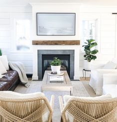 All interior walls and trim are painted in Benjamin Moore Super White Fireplace surround is Pietro Cardosa and the beam is reclaimed chestnut White Fireplace Surround, Fireplace Surrounds, Fireplace Design, Fireplace Ideas, Coastal Living Rooms, Coastal Homes, Home Living Room, Living Spaces, Beach House Decor