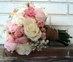 Cream, Pink Roses and Spray Roses with Baby's Breath and Cream and Pink Lisianthus tied with burlap ribbon — at The Bloom Closet.