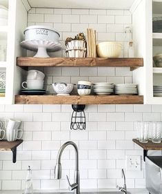 decor for open wood shelving in all white kitchen