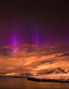 purple Aurora behind Mount Esja