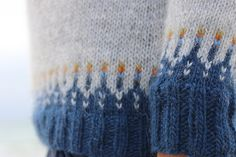 Ravelry: Ásta Sóllilja pattern by Kate Davies The little pops of orange are fabulous! To the yarn shop!