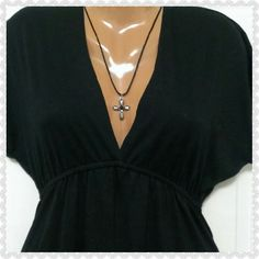 """V-neck little black dress from Mossimo Supply Measured length flat underneath the armpits across the chest is 18"""". Measured in the back from the top of the neck to the bottom of the dress is 35"""". It is an adorable little black v-neck by Mossimo Supply Company size small. Mossimo Supply Co Dresses"""