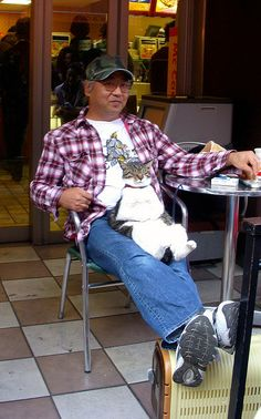 "A man in Harajuku and his cat in a very ""zen"" moment."