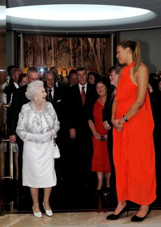 Queen Elizabeth II meets Australian basketball player Liz Cambage, 6 ft 8 in (2.03 m) tall, at a Parliamentary Reception at Parliament House in Canberra, Australia. (AP)