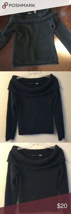 Gorgeous Black Winter Sweater Stunning and versatile black sweater converts from cowl neck to off-the-shoulder in a flash making this a day-to- night winner! Figure-flattering worn either way. Slight hint of shimmer really helps you stand out in a crowd. Unique mix of materials, including 30% angora rabbit hair, make this sweater oh so soft and warm!  010025-0110150 Hillard & Hanson Sweaters