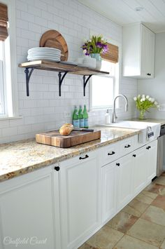Open shelving in a newly remodeled galley kitchen. www.chatfieldcourt.com