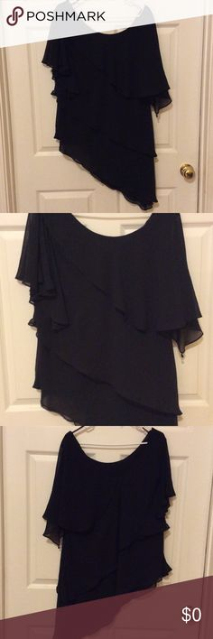 Beautiful asymmetrical chiffon blouse Beautiful black asymmetrical fully lined chiffon blouse with ruffles. Made of polyester this is in excellent condition. R&M Richards Tops Blouses