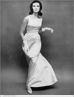Carmen in beautiful ivory satin shantung gown with skirt that bells to one side on a seam and swings out full a bit below the hip, by Mainbocher, photo by Richard Avedon, Harper's Bazaar, November 1959