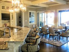 Transitional Kitchen with Hardwood floors, Mullion Pattern #1, Kitchen island, Complex granite counters, High ceiling