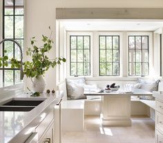 Beautiful and serene breakfast nook. Love the black windows against the soft palette.