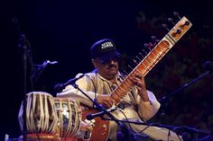 Indian sitar player Ashwin Batish performs with his Sitar Power band at the Ghanafest folk music festival in Floriana, outside Valletta | View photo - Yahoo Celebrity Philippines