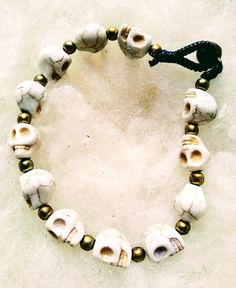 White Skull Bracelet with Golden Beads and Leather Fastener available to buy now in three colours from depop.com/isobeljane6  #80sfashion #80sstyle #90sfashion #90sdancejewellery #ravejewellery #gothfashion #hippychic #retrogoth #retro80s #alternativerock #alternative90s #skulljewelery #skullbracelet Skull Bracelet, Beaded Bracelets, Funky Jewelry, 80s Fashion, Jewelery, Colours, Beads, Retro, Leather
