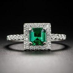 .61 Carat Emerald and Diamond Platinum Halo Ring - What's New