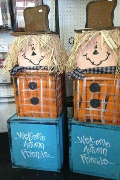 Tall scarecrow made of wooden boxes. Thanksgiving craft. Fall craft. I would drill two holes through the top of the middle box and put a broom handle through it, then place two garden gloves, one on each side of the broom, to represent hands.