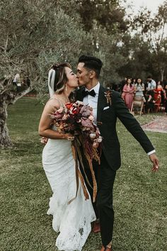 We love this couple's kiss at the end of the aisle! Celebrating being newlyweds | Image by Joy Zamora Wedding Event Planner, Destination Wedding, Bohemian Wedding Inspiration, Boho Wedding Decorations, Bridesmaids And Groomsmen, Boho Wedding Dress, Beautiful Moments, Wedding Season, Beautiful Bride