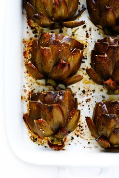 Seriously the most amazing roasted artichokes recipe! They're stuffed with lots of garlic and herbs, seasoned with lots of lemon and black pepper, and roasted to crispy, tender perfection. The perfect vegetable side dish! Vegetable Side Dishes, Vegetable Recipes, Vegetarian Recipes, Cooking Recipes, Healthy Recipes, Easy Recipes, Recipes Dinner, Healthy Food, Roasted Artichoke Recipe