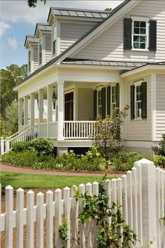 I love the coziness this house projects.....white picket fence...a house made for the movies