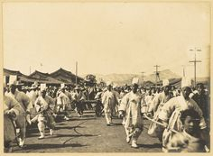 [Min Yong-hwan's state funeral procession] Seoul Dec 16-18 1905.  The grotesque figure on the cart pulled by the runners is a symbol for frightening off or propitiating evil spirits. Willard Dickerman Straight and Early U.S.-Korea Diplomatic Relations, Cornell University Library