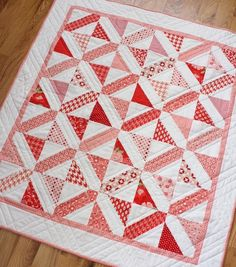 This quilt- as with many modern quilts- was inspired by an old-fashioned quilt block. Using solid white updated the look and off-set as well...