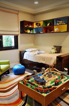 Colored Shadow Boxes, train table, cute rug, replace that chair with a bean bag