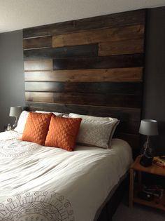 Floor to ceiling wood headboard.