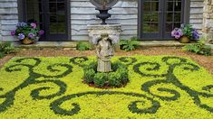 Smith designed this parterre in an elaborate scroll pattern made from low-maintenance dwarf mondo grass and chartreuse creeping Jenny. It requires some tending—two or three prunings a season Dwarf Mondo Grass, Landscape Design, Garden Design, Smith Gardens, Smoke Tree, Scroll Pattern, Clematis, Garden Inspiration, Houseplants