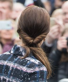 The Duchess decided against her usual bouncy curls and wore her hair swept back in a rolle...