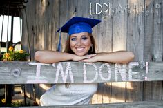 "seniors- ""I'm done"" written on a fence @Sadonna Patterson Lingnau maybe ""senior 2014"" written on it?"