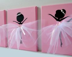 Set of three pink and grey handmade canvases with Dancing Ballerinas in tutus. Each canvas is 8 X 10. The background and ballerinas are painted with acrylic paint. Dancers are decorated with tulle dresses, lace, silk ribbons and crafted rozes.  Cute gift idea for baby shower or any ballerina lover.