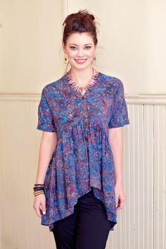 Oh-so-darling, this sweet flowy blouse features a batik print in a blue hue. Designed with button-up closures at the front and a flowy hemline for a romantic-inspired feel, this lovely blouse can be s